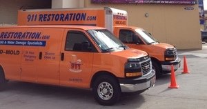 Water Damage Metairie Vans At Commerical Job Location