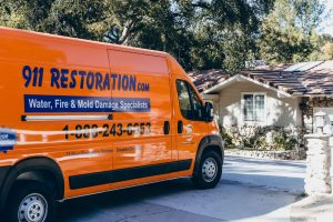 disaster restoration van in front of residence