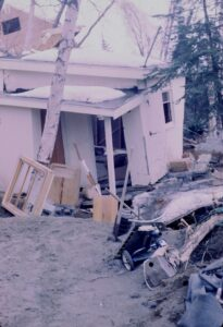A structurally damaged home after an earthquake